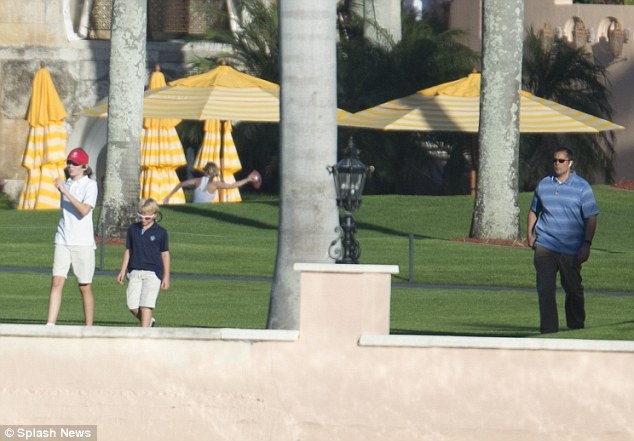 Barron and another boy were followed by security as they walked closer to the water's edge