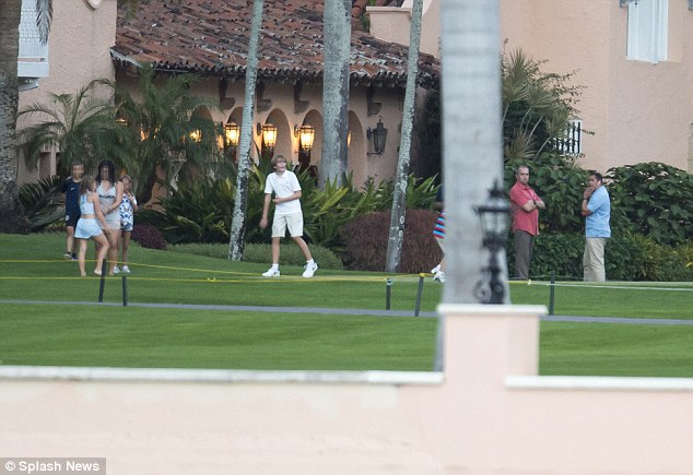 The security detail watched Barron's every move as he played in the back garden of the estate