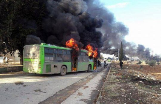Activists said militants have burned at least five buses assigned to evacuate wounded and sick people from two villages in northern Syria.  (Syrian Arab News Agency via AP)
