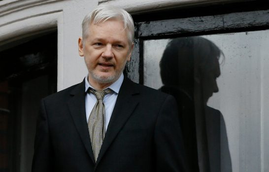 Julian Assange, the founder of WikiLeaks, on the balcony of the Ecuadorean Embassy in London last year. He took refuge there almost five years ago. (Credit: Kirsty Wigglesworth/Associated Press)