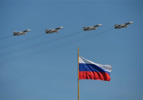 Su-24M frontline bombers during the aerial part of the military parade in Moscow to mark the 71st anniversary of Victory in the 1941-1945 Great Patriotic War. (Evgeny Biyatov/Sputnik via AP)