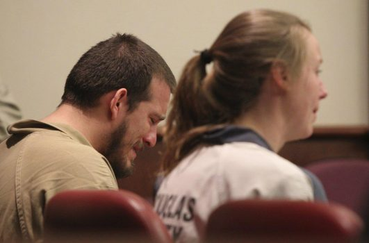 Jose Torres and Kayla Rae Norton wept in court on Monday when sentenced for what the judge called a hate crime. (HENRY P. TAYLOR/AP)
