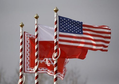 U.S. (R to L), Poland's flags and jack of the President of Poland are seen during the inauguration ceremony of bilateral military training between U.S. and Polish troops in Zagan, Poland, January 30, 2017. REUTERS/Kacper Pempel