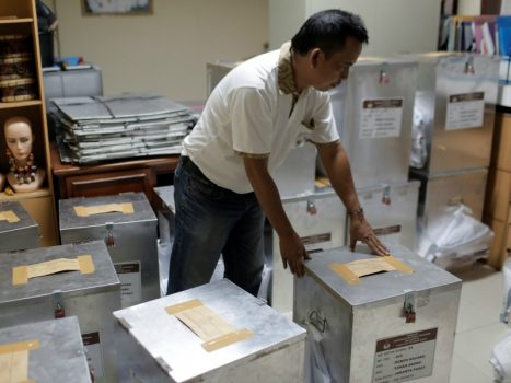 An election official prepares ballot boxes before distributing them to polling stations on April 18, 2017, in Jakarta, Indonesia. (Photo by Beawiharta/REUTERS)