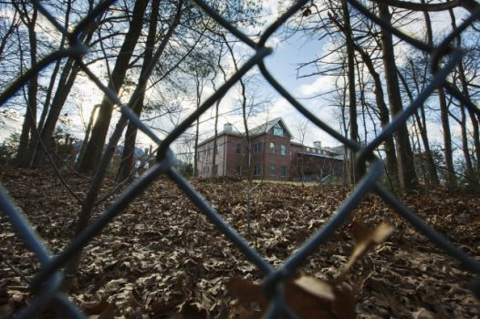 A fence encloses an estate in the village of Upper Brookville in the town of Oyster Bay, N.Y., on Long Island on Dec. 30, 2016. (Alexander F. Yuan/Associated Press)