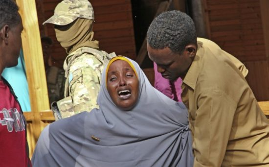 "A mother whose daughter was shot in the head by attackers during a militant attack on a restaurant, grieves in Mogadishu, Somalia Thursday, June 15, 2017. Somalia's security forces early Thursday morning ended a night-long siege by al-Shabab Islamic extremists at the popular ""Pizza House"" restaurant in the capital. (Farah Abdi Warsameh/Associated Press)"