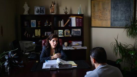 Immigration attorneys in Michigan, like Chaldean Eman H. Jajonie-Daman, meet with Christian clients seeking to avoid deportation to Iraq. (Image: Salwan Georges/The Washington Post via Getty Images)