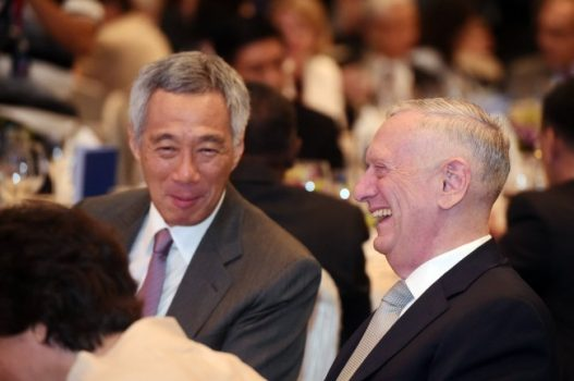 U.S. Defense Secretary Jim Mattis, right, sits with Singapore's Prime Minister Lee Hsien Loong as they attend the opening dinner of the 16th International Institute for Strategic Studies Shangri-la Dialogue, or IISS, Asia Security Summit on Friday, June 2, 2017 in Singapore. (Joseph Nair/Associated Press)