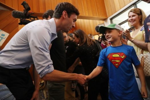 Democratic candidate Jon Ossoff shakes hands with Grayden Auchincloss, 8, during a visit to a campaign office to thank volunteers and supporters. (Joe Raedle/Getty Images)