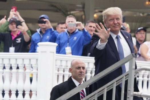President Trump waves to spctators at the U.S. Women's Open at Trump National Golf Club. (Kelvin Kuo/USA Today Sports)