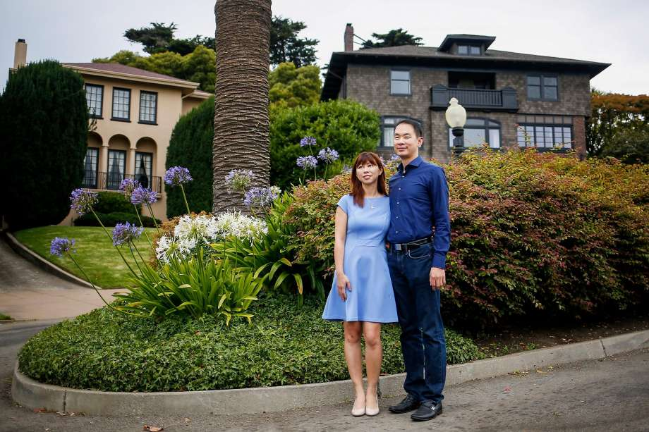 Tina Lam and Michael Cheng have bought Presidio Terrace, a private street lined with expensive homes. Residents apparently had no idea the common spaces were up for sale. (Photo: Nicole Boliaux, The Chronicle)