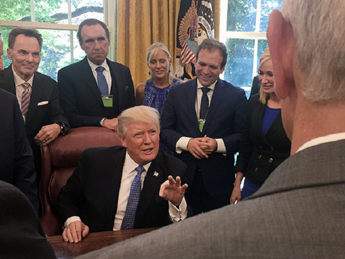 Ronnie Floyd, from left, Rodney Howard-Browne, Adonica Howard-Browne, Johnnie Moore, and Paula White stand behind President Trump as he talks with evangelical leaders on July 10, 2017, in the White House. (Photo courtesy of Johnnie Moore)