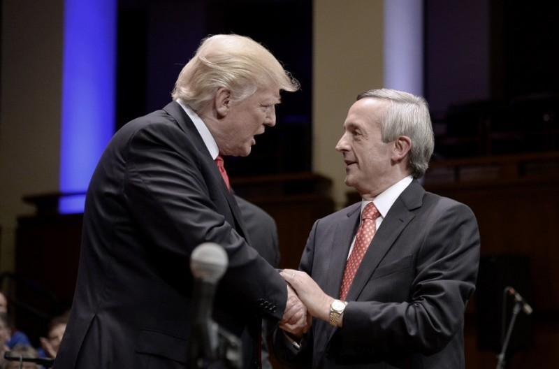 President Trump greets Pastor Robert Jeffress on July 1, 2017, during the Celebrate Freedom Rally at the John F. Kennedy Center for the Performing Arts in Washington. Pool photo by Oliver Douliery/European Pressphoto Agency)