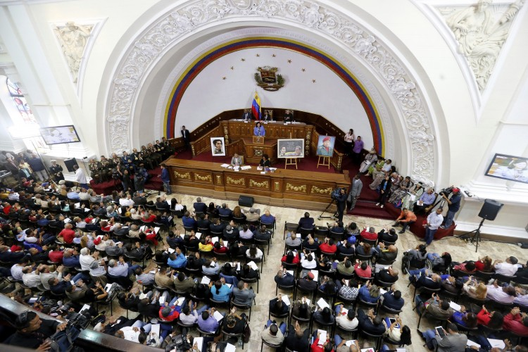 Constitutional Assembly delegate Carmen Melendez speaks from the podium during a session in Caracas, Venezuela, Tuesday, Aug. 8, 2017.  (Ariana Cubillos/Associated Press)