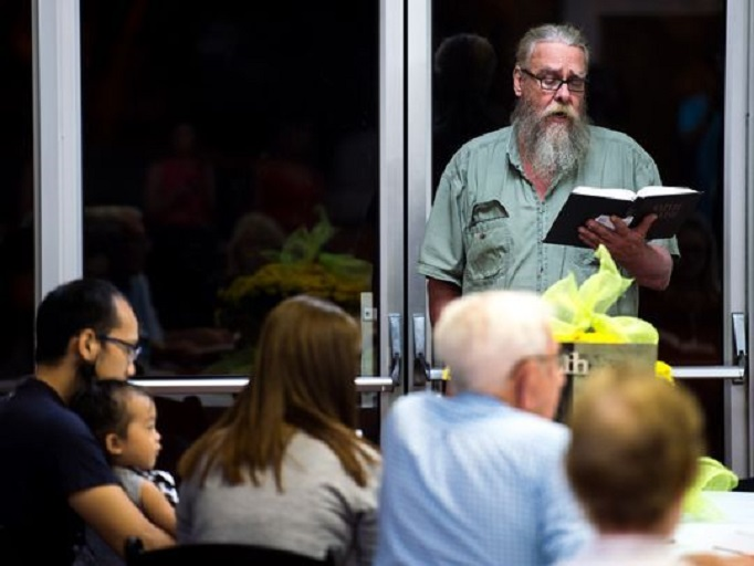 Church member Danny Carter leads attendees in song during Wednesday service at Burnette Chapel Church of Christ in Antioch, Tenn., on Sept. 27, 2017. The service was the first to be held in the church since Sunday's shooting. (Photo: Andrew Nelles / The Tennessean)