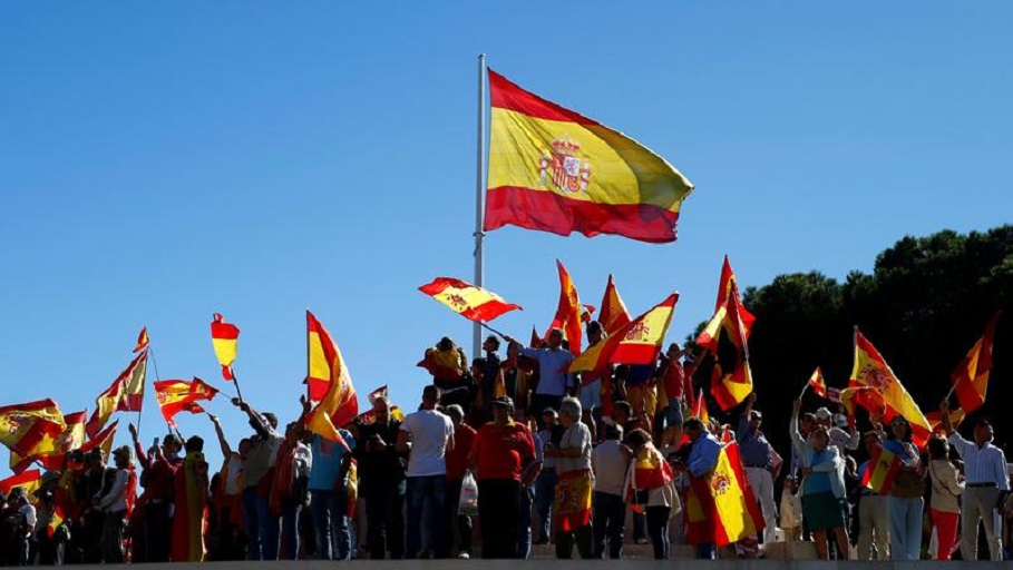 People wave Spain´s flag at a pro-union demonstration in Madrid, October 7, 2017. REUTERS/Javier Barbancho