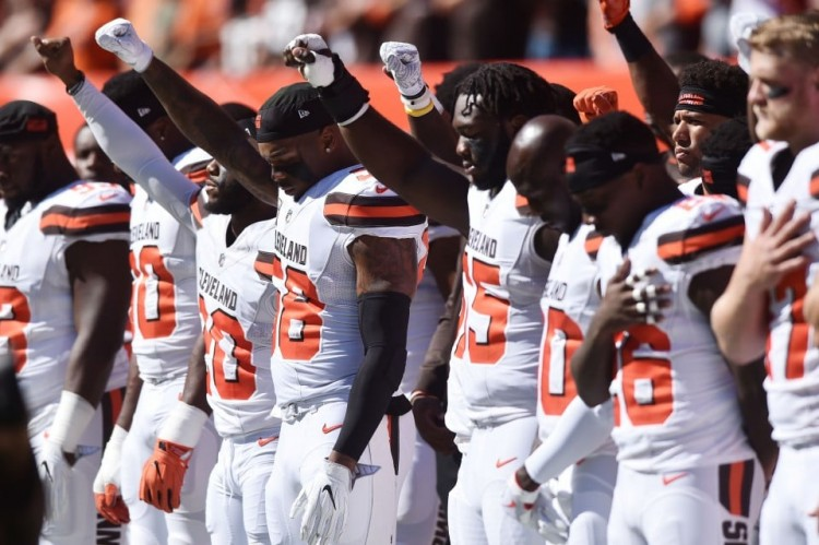 Members of the Cleveland Browns raise their fists during the national anthem Sunday. (Ken Blaze/USA TODAY Sports)