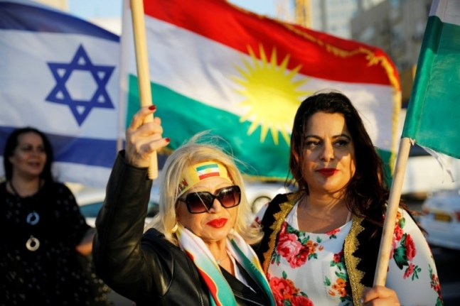 Israelis mainly of Kurdish origin take part in a gathering outside the American Embassy in Tel Aviv on Oct. 26. (Amir Cohen/Reuters)