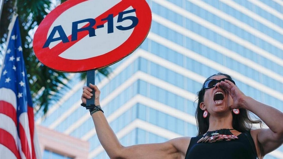 "Alessandra Mondolfi yells, ""No More"" during a protest against guns on the steps of the Broward County Federal courthouse in Fort Lauderdale, Fla., on Feb. 17, 2018. (Brynn Anderson, AP)"