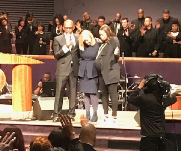 Pastor Joseph Walker III prays with Nashville Mayor Megan Barry.