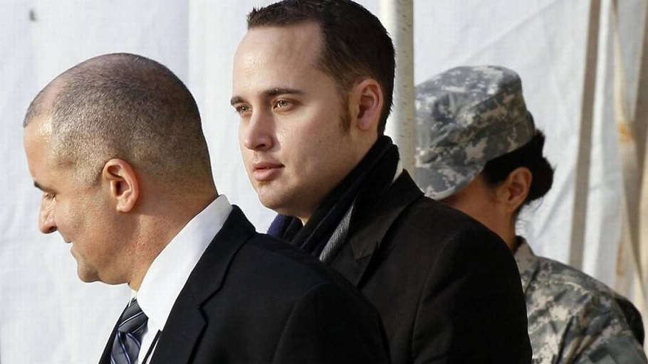 Adrian Lamo, center, walks out of a courthouse in Fort Meade, Md., on Dec. 20, 2011, after testifying at a military hearing against Army Pfc. Bradley, later Chelsea, Manning. (File photo: Associated Press)