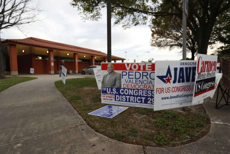 Campaign signs outside of the Moody Park Community Center as early voting winds down, Thursday, March 1, 2018, in Houston. Early voting for Harris County ends Friday. (Karen Warren / Houston Chronicle)