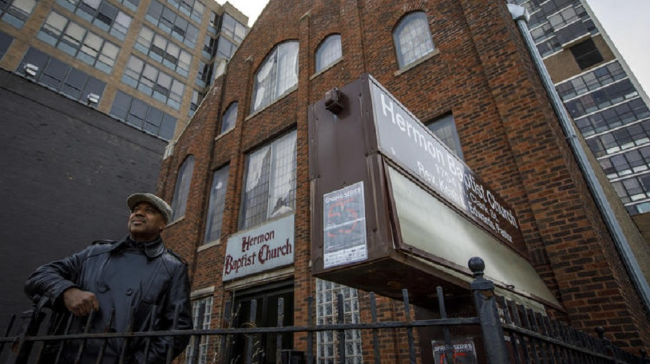 Pastor Keith Edwards speaks about the history of the shuttered Hermon Baptist Church in Lincoln Park on March 19, 2018. (Brian Cassella / Chicago Tribune)