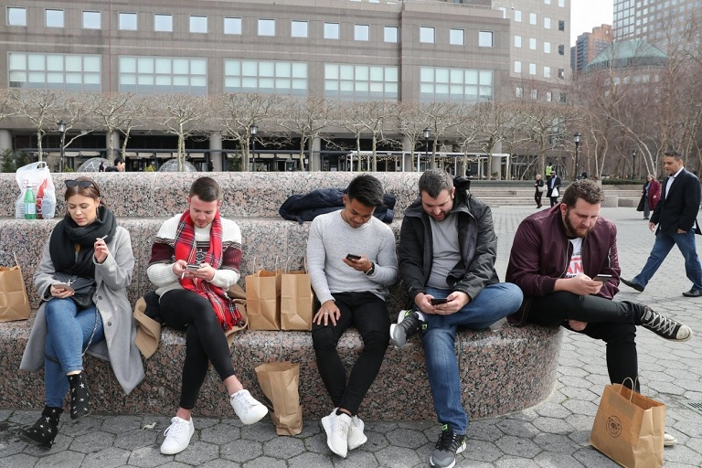 Some five dozen iPhone customers have filed at least 59 separate lawsuits since December over the throttled-phone issue. PHOTO: ELIZABETH SHAFIROFF FOR THE WALL STREET JOURNAL