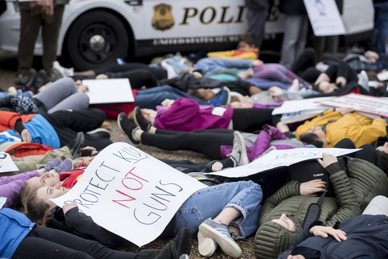 Washington, D.C., area students and supporters protest against gun violence with a lie-in outside of the White House on Monday, Feb. 19, 2018. (Photo By Bill Clark/CQ Roll Call)