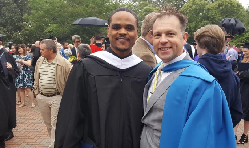 Sean Robinson, left, stands next to professor Stephen Eccher at the commencement ceremony at Southeastern Baptist Theological Seminary in May 2017. Robinson graduated May 11, 2018, with another master's degree. (Photo courtesy Sean Robinson)