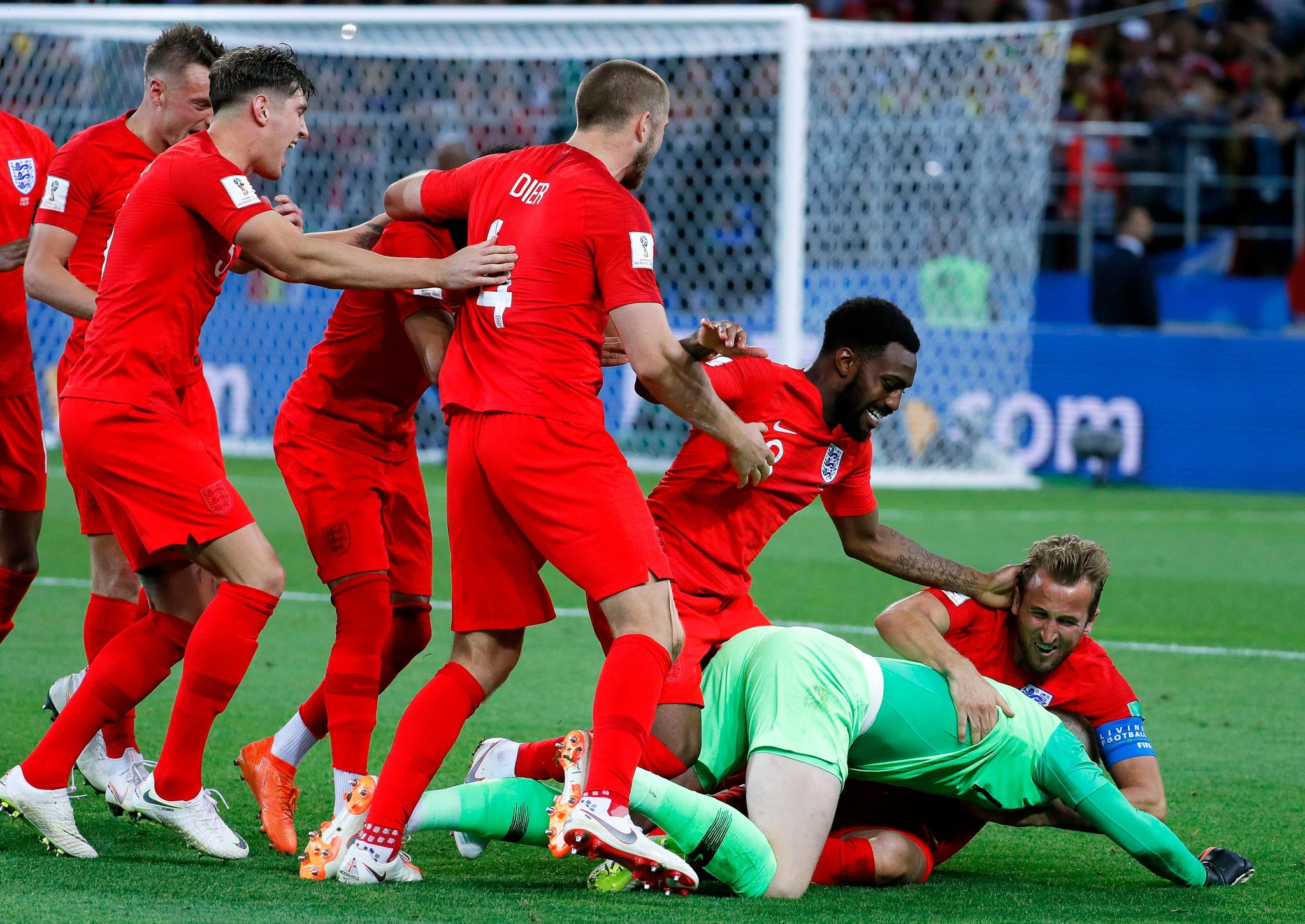 England's players celebrated after defeating Colombia in a penalty shootout. (Credit: Yuri Kochetkov/EPA, via Shutterstock)