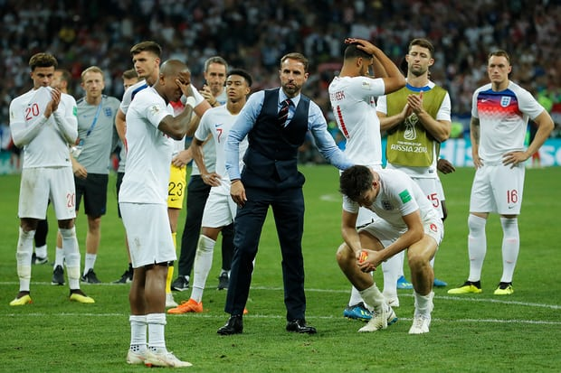 Gareth Southgate consoles his players. (Photograph: Tom Jenkins for the Guardian)