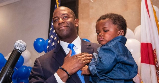 Andrew Gillum, Democratic candidate for governor, holds his son Jackson during his election watch party, Aug. 28, 2018, in Tallahassee, Fla.