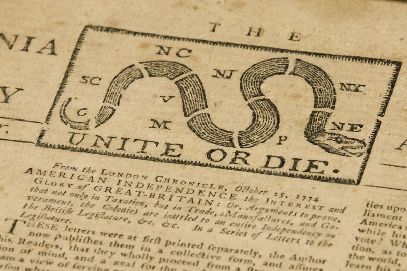 """This photo shows a detail of a Dec. 28, 1774 Pennsylvania Journal and the Weekly Advertiser at the Goodwill Industries in Bellmawr, N.J., Thursday, Oct. 25, 2018. A quick eye by Goodwill workers in southern New Jersey turned up the original 1774 Philadelphia newspaper with an iconic """"Unite or Die"""" masthead. (AP Photo/Matt Rourke)"""