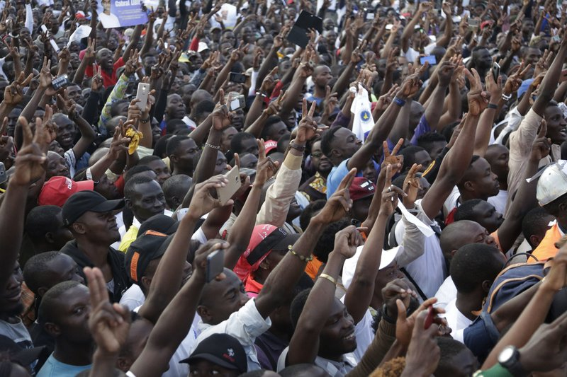 Supporters of Opposition Presidential candidates, Cabral Libii, shout slogans during an election campaign rally outside the Ahmadou Ahidjo Stadium in Yaounde, Cameroon, Saturday, Oct. 6, 2018. Separatists who have declared an English-speaking state in parts of Cameroon are threatening Sunday's election, one that Africa's oldest leader should win easily _ but with a weakened mandate if people stay away from the polls. (AP Photo/Sunday Alamba)