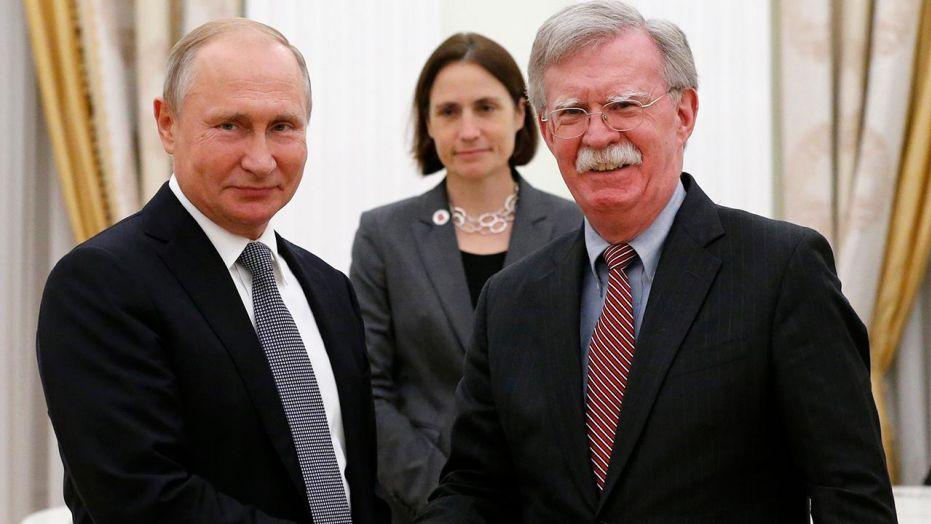 Vladimir Putin and National Security Adviser John Bolton