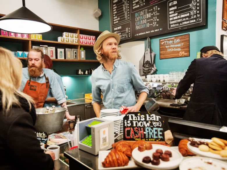 A cafe in Stockhlom that is completely cash-free. Few places are tilting toward a cashless future as quickly as Sweden, which has become hooked on the convenience of paying by app and plastic. (Linus Sundahi-Djerf/The New York Times)