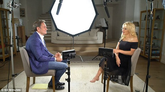 'This Me Too movement is a bit too much for me': Pamela Anderson (right) claims third wave feminism is a 'bore' that 'paralyses men'. Pictured left, 60 Minutes journalist Liam Bartlett.