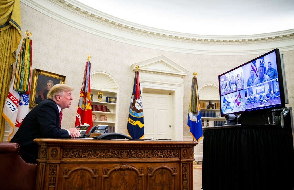 President Trump spoke from the Oval Office to members of the military stationed in Guam, Bahrain, Qatar and Alaska on Christmas Day. (Credit: Al Drago for The New York Times)