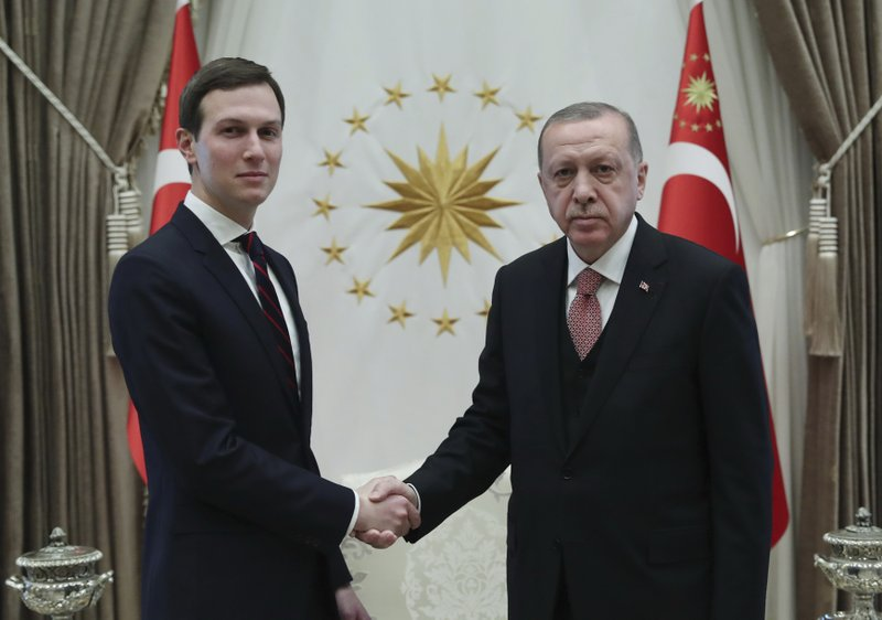 Turkey's President Recep Tayyip Erdogan, right, shakes hands with Jared Kushner, left, U.S. President Donald Trump's adviser, prior to their meeting at the Presidential Palace in Ankara, Turkey, Wednesday, Feb. 27, 2019. Erdogan met with with U.S. President Donald Trump's adviser and son-in-law for talks that are expected to centre on his planned Mideast peace initiative. Turkey's Economy Minister Berat Albayrak, who is Erdogan's son-in-law, was also present. (Presidential Press Service via AP, Pool)