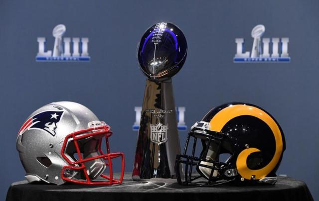 FILE PHOTO: Jan 30, 2019; Atlanta, GA, USA; The Vince Lombardi Trophy and helmets for the New England Patriots and Los Angeles Rams are displayed before the Roger Goodell press conference in advance of Super Bowl LIII at Georgia World Congress Center. REUTERS/Mandatory Credit: Kirby Lee-USA TODAY Sports/File Photo