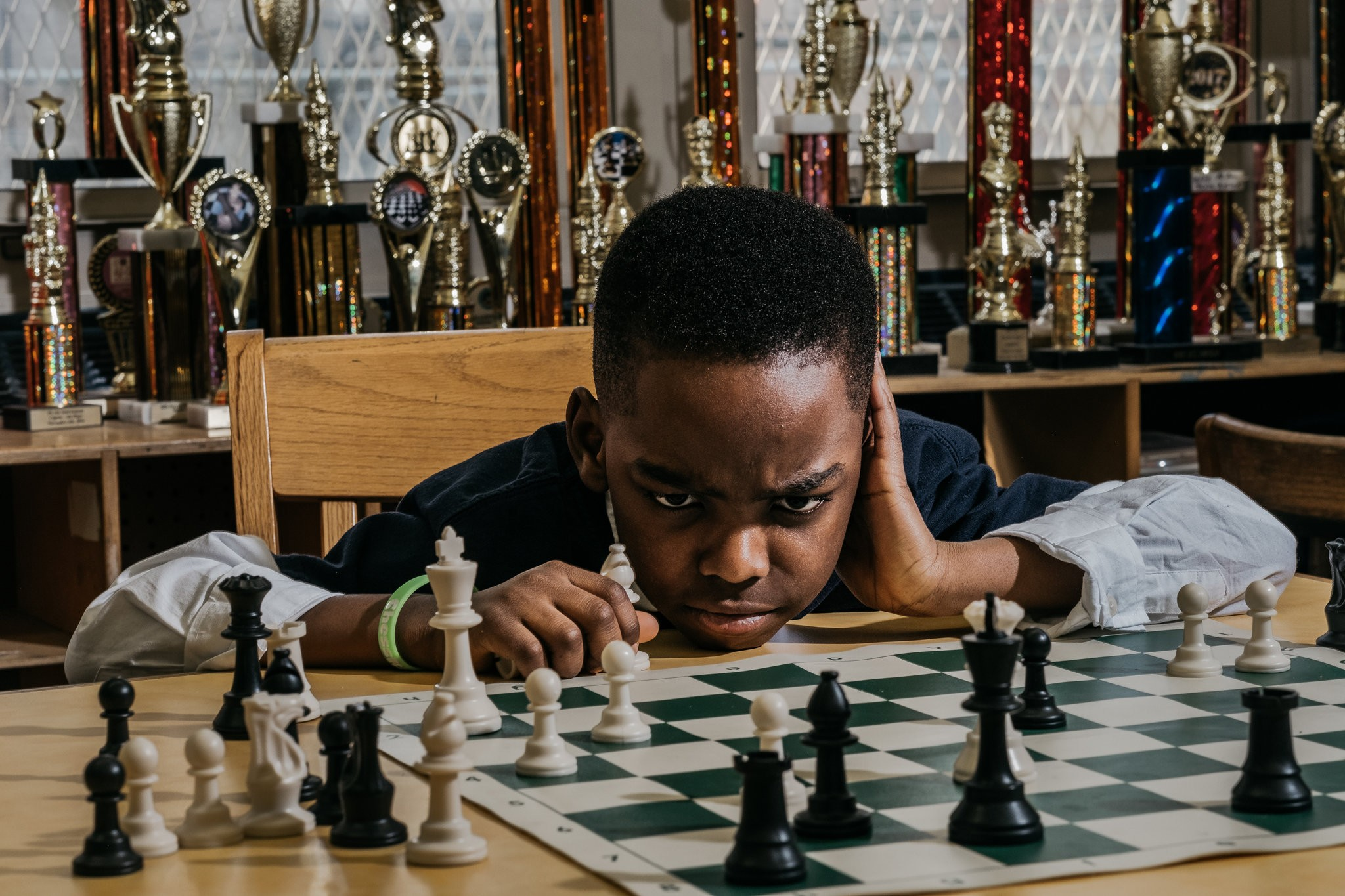 Tanitoluwa Adewumi, who lives with his family in a shelter in New York City, went from chess novice to chess champion in little over a year. (Credit: Christopher Lee for The New York Times)