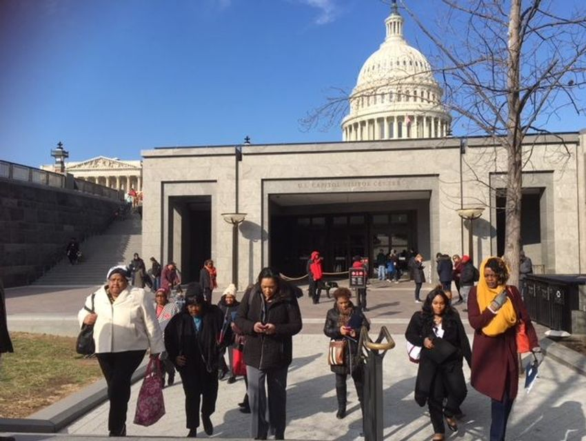 Women attending the Black Women's Roundtable summit March 14, 2018, head to Senate offices in Washington to discuss issues that affect communities of color. (Photo: Deborah Barfield Berry, USA TODAY)