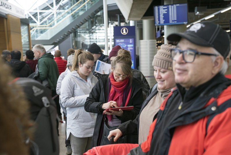 Stranded passengers set to travel with Icelandic airline Wow, wait in line at Iceland's international airport in Keflavik, Thursday March 28, 2019. Icelandic budget airline WOW Air ceased operations on Thursday, stranding passengers across two continents. The airline told passengers there would be no further flights and advised them to check flights with other airlines for ways to reach their destinations. (AP Photo/Egill Bjarnason)