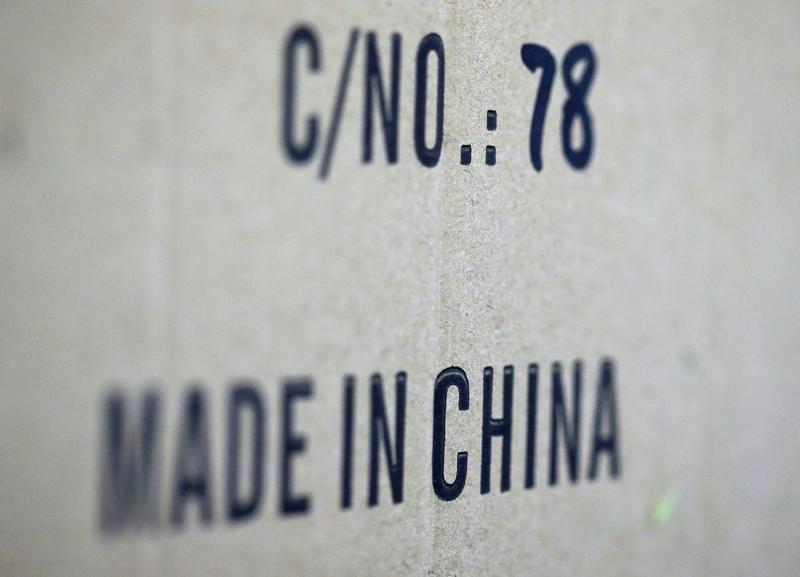 FILE PHOTO: Words 'Made in China' are pictured on a box of products imported from China at a wholesale shop in Paris, France. REUTERS/Regis Duvignau/File Photo