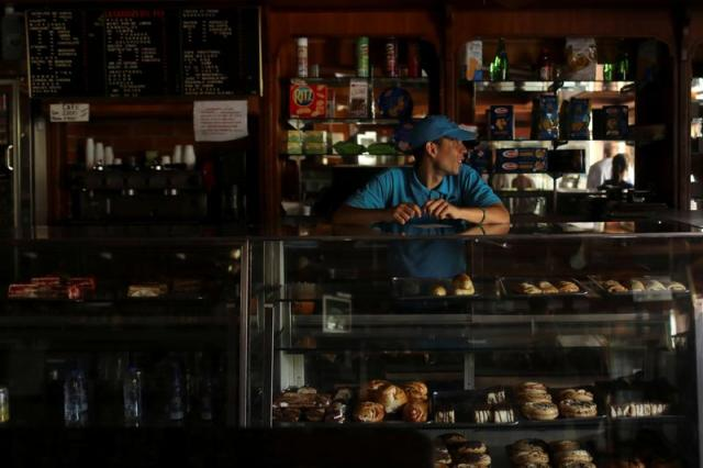 A worker stands inside a bakery during an ongoing blackout in Caracas, Venezuela March 10, 2019. (REUTERS/Manaure Quintero)