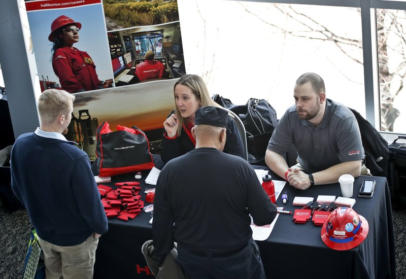 FILE- In this March 7, 2019, file photo visitors to the Pittsburgh veterans job fair meet with recruiters at Heinz Field in Pittsburgh. On Friday, April 5, the U.S. government issues the March jobs report. (AP Photo/Keith Srakocic, File)