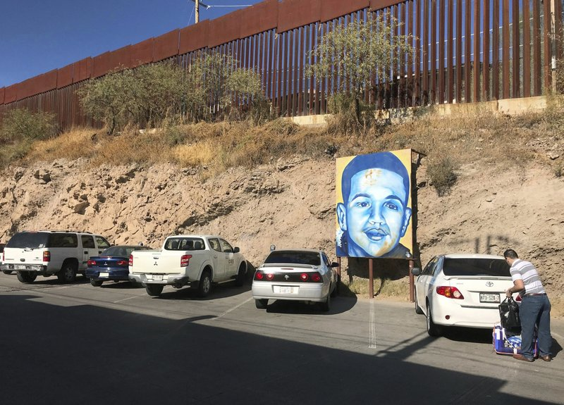 FILE - In this Dec. 4, 2017, file photo, a portrait of 16-year-old Mexican youth Jose Antonio Elena Rodriguez, who was shot and killed in Nogales, Sonora, Mexico, is displayed on the Nogales street where he was killed that runs parallel with the U.S. border. The Trump administration says families of Mexican teenagers who were shot to death by American border agents should not be allowed to sue for damages in U.S. courts. The administration is telling the Supreme Court in a brief filed April 11, 2019, that the justices should take up and resolve the issue in favor of two agents who fired shots across the U.S-Mexican border that killed the teenagers. (AP Photo/Anita Snow, File)