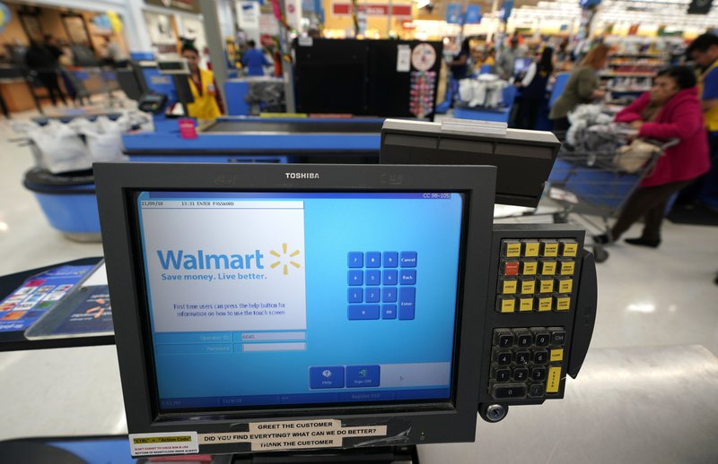 FILE- This Nov. 9, 2018, file photo shows a checkout scanner at a Walmart Supercenter in Houston. Walmart says it's buying San Francisco-based ad tech startup Polymorph Labs as it looks to better compete with online rival juggernaut Amazon in targeting shoppers online. The world's largest retailer has been quietly building its own advertising business with a unit called Walmart Media Group though that business is still smaller than Amazon's. (AP Photo/David J. Phillip, File)