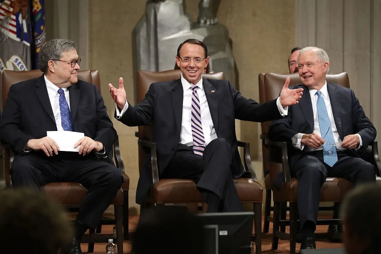 From left, Attorney General William P. Barr, Deputy Attorney General Rod J. Rosenstein and former attorney general Jeff Sessions share a laugh during Rosenstein's farewell ceremony at the Justice Department on Thursday. (Chip Somodevilla/Getty Images)